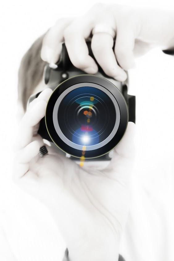 Obrázek člověk a s fotoaparátem